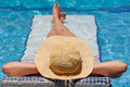 Relaxing on swimming pool bed Stock Photography