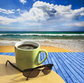 Relaxing view with coffee a mug of at stunning seaside location Royalty Free Stock Photography