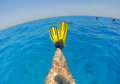 Relaxing in the water diver swimmer cross legs with yellow fins clear blue tropical sea red sea egypt Stock Photos