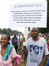 Religion and justice for trayvon martin photo of of black man holding a religious sign wearing a t shirt in support of at the th Royalty Free Stock Photography