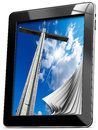 Religion tablet computer with pages and monitor wooden high cross blue sky clouds and reflection Stock Images