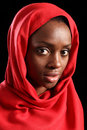 Religious african muslim woman in red headscarf Royalty Free Stock Images