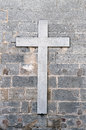 Religious cross on old wall Stock Images