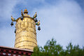 Religious gold symbol on top of a temple lhasa Royalty Free Stock Photography