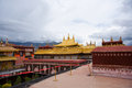 Religious gold symbol on top of a temple lhasa Stock Photos