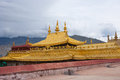 Religious gold symbol on top of a temple lhasa Stock Photo