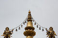 Religious gold symbol on top of a temple in lhasa china Royalty Free Stock Photo