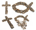 Religious icons two christian crosses and two ichthys jesus fish made of pebbles and stones against a white background Royalty Free Stock Images