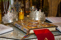 Religious objects gospel book and crowns for wedding ceremony Stock Photo