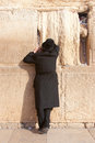 A religious orthodox Jew prays at the Wailing Wall Stock Photography