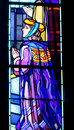 Religious picture on stained glass in the church Royalty Free Stock Photo