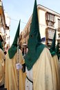 Religious procession holy week malaga spain members of the pollinca brotherhood walking through the streets during the festival of Royalty Free Stock Photos