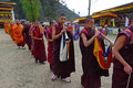 Religious procession of monks making music during the paro tsechu festival in paro bhutan Stock Photography