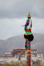Religious tibetan symbol with the potala palace lhasa in background tibet Stock Images