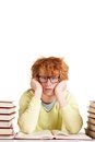 Reluctant to read portrait of redhead student in eyeglasses looking at camera while reading Stock Image
