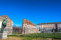 Remain of roman walls in turin italy europe march the with the archeological museum the background Royalty Free Stock Images