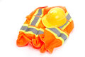 Remember safety first vest and hard hat on white background Stock Photos
