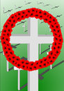 Remembrance crosses a poppy wreath over a background of shadowed on a graduated green ground Stock Images