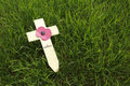 Remembrance day wooden cross with red poppy on the green lawn Stock Images