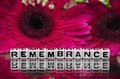 Remembrane text with flowers in the background Stock Images