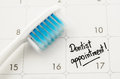Reminder dentist appointment in calendar with toothbrush Stock Image