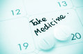 Reminder take medicine on calendar written and pills Royalty Free Stock Photography