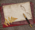 Reminiscence vintage still life with pen paper and eyeglasses on wood background Royalty Free Stock Image