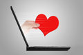 Remote assistance concept hand give out a red heart out of the laptop Stock Image