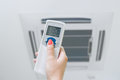 Remote control and air conditioning Royalty Free Stock Photo