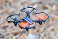 Remote controlled quadcopter drone in mid air Royalty Free Stock Image