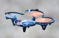Remote controlled quadcopter drone in mid air Royalty Free Stock Images