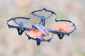 Remote controlled quadcopter drone in mid air Stock Image