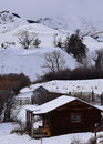 Remote winter hideaway rustic log cabin nestled in the mountains Royalty Free Stock Images