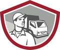 Removal man delivery van shield retro illustration of a guy with moving truck in the background set inside on isolated background Stock Images
