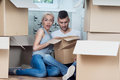 Removal is not easy thing beautiful fair haired girl sitting on the floor with her handsome husband surprised because she forgot Stock Images