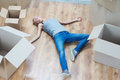 Removal is not easy thing full length portrait of beautiful blonde wearing nice t shirt and jeans lying on the floor exhausted Stock Photo