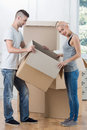 Removal is not easy thing full length portrait of happy smiling couple standing and thinking about the problem of dividing the Stock Photography