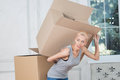 Removal is not easy thing half length portrait of beautiful blonde wearing nice grey vest and holding empty box on her back and Stock Image