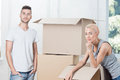 Removal is not easy thing half length portrait of lovely couple standing near the boxes and having a rest after hard Stock Photos