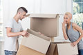 Removal is not easy thing half length portrait of lovely smiling girl and busy men holding big empty box and thinking about Royalty Free Stock Photo
