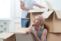 Removal is not easy thing half length portrait of young fair haired girl sitting among the boxes and because of her and waiting Stock Image