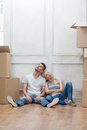 Removal is not easy thing lovely couple sitting on the floor and leaning against the wall tired because of hard Royalty Free Stock Photo