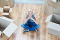 Removal is not easy thing lovely fair haired girl sitting on the floor among the boxes and thinking how she wants to furnish her Royalty Free Stock Photo