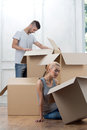 Removal is not easy thing nice couple opening cardboard boxes because of quick Stock Photos
