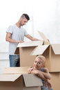 Removal is not easy thing nice couple opening cardboard boxes because of quick Stock Images