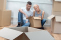 Removal is not easy thing selected focus on the big cardboard empty box lying on the floor tired lovely couple looking in the box Stock Image