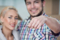 Removal is not easy thing selected focus on keys of the new house smiling happy couple on background Royalty Free Stock Photo