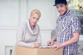 Removal is not easy thing woman wearing nice warm cardigan and men in checked shirt signing some important document Stock Photos
