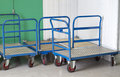 Removal trolleys at self storage centre with blue handles Royalty Free Stock Photos