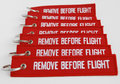 Remove before flight ribbons on white background Stock Photo
